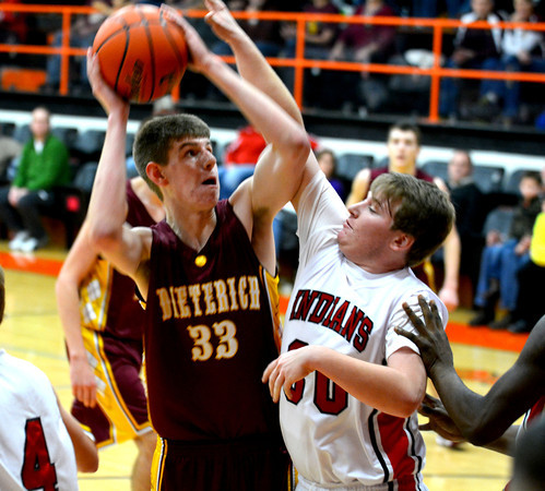 Dieterich's Devin Aherin goes for a layup in the post against Neoga's Brock Aleshire at the third-place game of the National Trail Conference tournament.