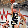 Teutopolis' Anna Hartke goes for a layup despite having one eye covered by Effingham's Stephanie Robb.