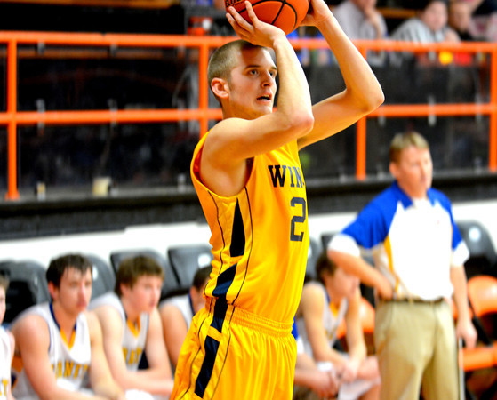 Windsor's Tristan Warner rises up for a three-pointer in front of the Cowden-Herrick bench during the opening game at the National Trail Conference tournament in Altamont.