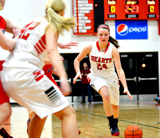 Effingham's Felicia Totten dribbles up court while Stephanie Robb (left) posts up.