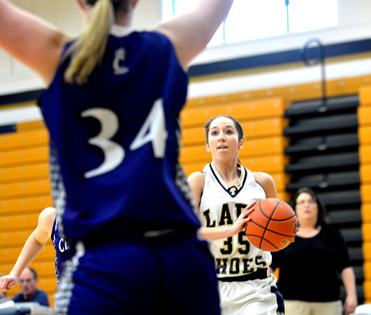 Teutopolis' Cierra Thompson pulls up for a jump shot over the defense of Breese Central's Kendra Wilken (34).