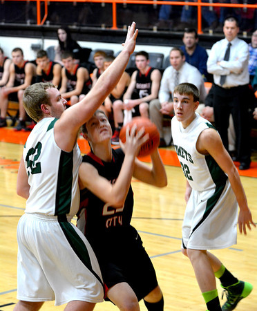 Beecher City's Jacob Kenter works for position in the post despite a double team from Stew-Stras