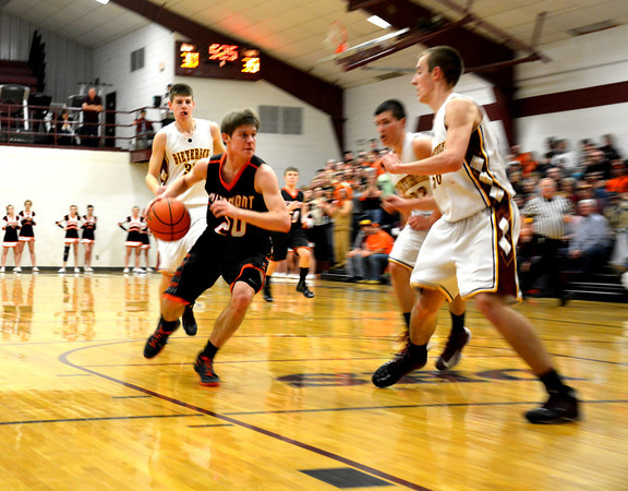 Altamont's Garrett Ziegler takes the ball into the lane despite multiple defenders from Dieterich.