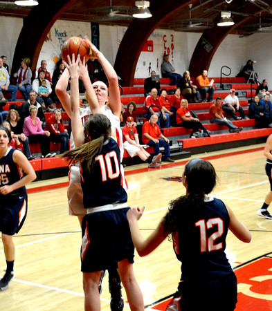 Neoga's Jillian Deters puts up a shot in the post while being defended by Pana's Lexie Siegrist.