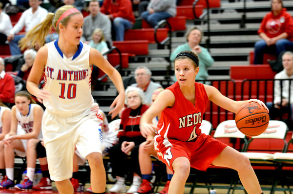 Neoga's Madison Butler crosses over and changes directions while being guarded by St. Anthony's Morgan Gardewine.