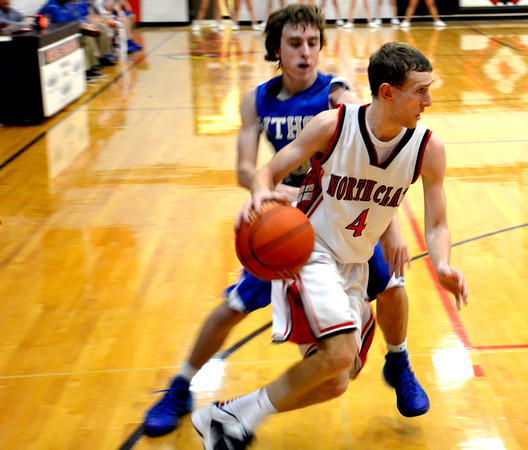 North Clay's Garrett Rubsam blows by a Webber Township defender during the Cardinals' MTC tournament win.