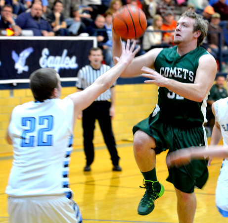 Stew-Stras' Jason Fry goes for a layup against St. Elmo/Brownstown.