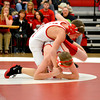 Effingham's Brody Beck works for position against Lawrenceville's Curtis Meek in the 106-pound weight class.