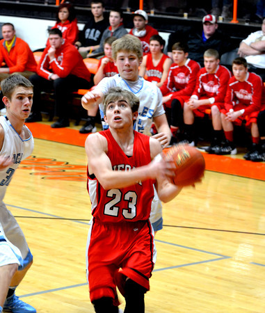 Neoga's Wyatt Krikie slips past the St. Elmo/Brownstown defense for an easy layup during the Indians' quarterfinal win at the National Trail Conference tournament.