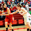 St. Anthony's Lauren Wendt is closely guarded by Effingham's Lauren Stephenson at the Effingham Round Robin Tournament.