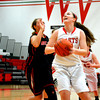 Effingham's Lauren Stephenson catches an entry pass in the post and spins toward the basket for a layup during the Lady Hearts' come-from-behind victory against Mt. Zion.