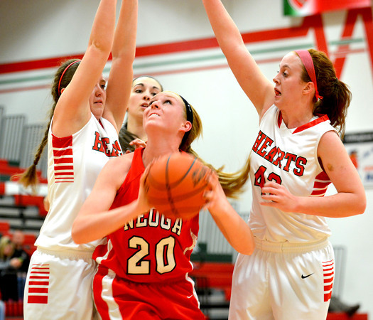 Neoga's Jillian Deters puts up a layup despite a trio of defenders from Effingham — Lauren Stephenson, Brittany Beals and Josie Zerrusen, from left.