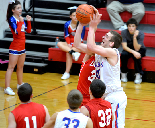 St. Anthony's John Goeckner goes for a layup over a Lawrenceville defender during the St. Anthony Shootout.