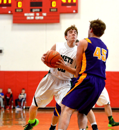 Stew-Stras' Brandon Helmuth collides with a defender from Mt. Pulaski during the St. Anthony Shootout.