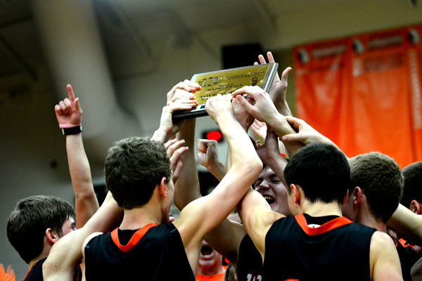 The Altamont Indians celebrate their NTC tournament championship with their plaque following their 49-38 win over St. Anthony.
