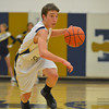 Teutopolis' Michael Drees dribbles the ball upcourt against Mattoon.