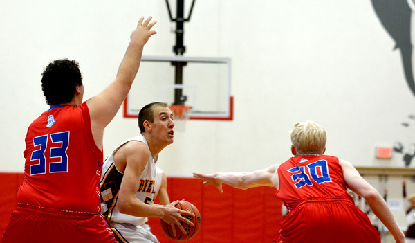 Dieterich's Travis Niemerg goes for a layup between a double team from Waltonville at the St. Anthony Shootout.