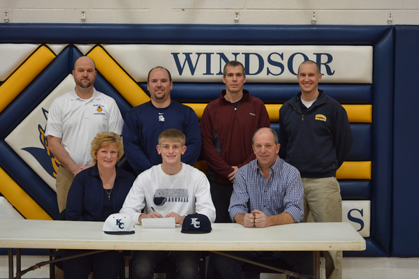 Windsor's Alex Allen (center front) signs to play baseball at Kaskaskia College at Windsor High School. With him in the front row are his parents, Susie and Rick. Back row, from left: Windsor principal Erik Van Hoveln, Kaskaskia head coach Mitch Koester, Windsor Athletic Director and Windsor/Stew-Stras baseball coach Mike Taylor, and Windsor basketball coach Silas Pogue.