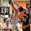 Altamont's Klaiton Wolff gets fouled by Vandalia's Carson Smith.