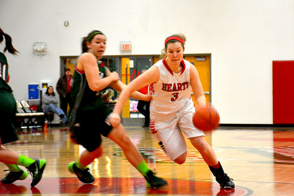 Effingham's Jantzen Michael drives past Salem's Kailey Beer and gets into the lane during Effingham's 59-50 win. The win set a school record for most consecutive wins.