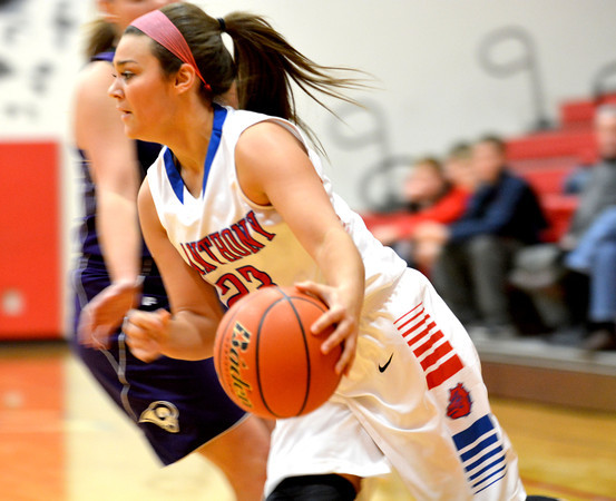 St. Anthony's Makayla Walsh dribbles past a Shelbyville defender in her first game back from a knee injury.