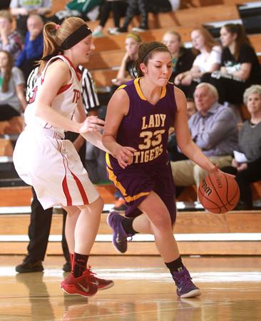 1-22-15<br /> Northwestern vs Taylor basketball<br /> Northwestern's Sydney Zeck dribbles away from Taylor.<br /> Kelly Lafferty Gerber | Kokomo Tribune