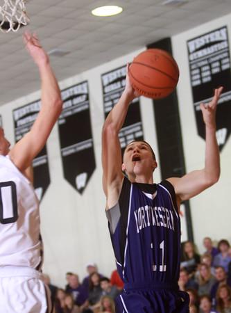 1-17-14<br /> Northwestern vs Western county tournament championship<br /> Northwestern's Austin Miller shoots.<br /> Kelly Lafferty Gerber | Kokomo Tribune