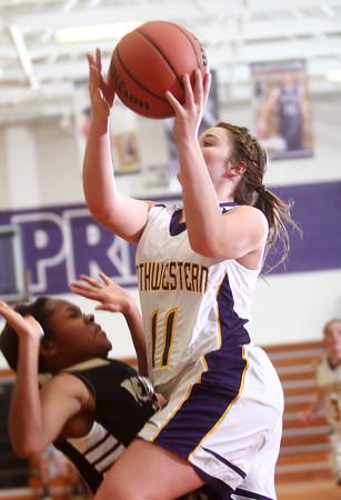 1-20-15<br /> Northwestern vs Peru basketball<br /> Northwestern's Whitney Zeck goes to the basket.<br /> Kelly Lafferty Gerber | Kokomo Tribune