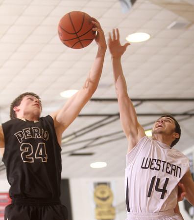 1-30-15<br /> Western vs Peru basketball<br /> Peru's Logan Primerano and Western's Tanner Degenkolb go for a rebound.<br /> Kelly Lafferty Gerber | Kokomo Tribune