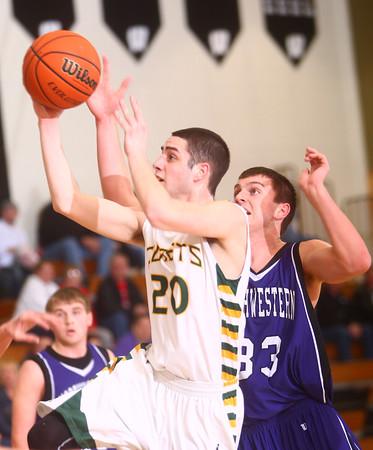 1-16-15<br /> Boys Basketball County Tournament<br /> Eastern's Noah Cope goes for a shot as Northwestern's Derek Doubet tries to stop him.<br /> Kelly Lafferty Gerber | Kokomo Tribune