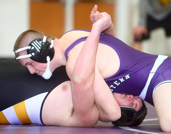 1-14-15<br /> Northwestern vs Pioneer wrestling<br /> Northwestern's Max Clark vs Pioneer's DJ Raderstorf<br /> Kelly Lafferty Gerber | Kokomo Tribune