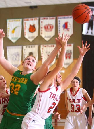1-10-15<br /> EHS vs Taylor basketball<br /> Eastern's Taylor Holliday and Taylor's Cami Hansen both go for a rebound.<br /> Kelly Lafferty Gerber   Kokomo Tribune