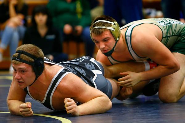 Eastern's Evan Ellis and Eastbrook's Joe Little  in the 220 weight class in the wrestling sectionals on Saturday Jan. 31, 2015.<br /> Tim Bath | Kokomo Tribune