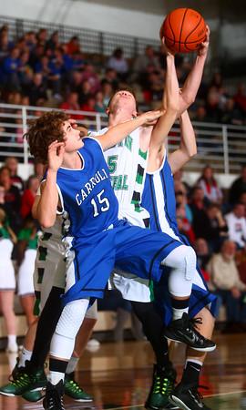 1-2-15<br /> Clinton Central vs Carroll basketball<br /> Carroll's  Trey Filbrun and Clinton Central's Logan Adams go up for a rebound.<br /> Kelly Lafferty Gerber | Kokomo Tribune