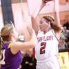 1-22-15<br /> Northwestern vs Taylor basketball<br /> Taylor's Cami Hansen tries to keep the ball away from Northwestern's defense.<br /> Kelly Lafferty Gerber | Kokomo Tribune