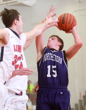 1-23-15<br /> Northwestern vs Cass basketball<br /> Northwestern's Jacob Wagner puts up a shot.<br /> Kelly Lafferty Gerber | Kokomo Tribune