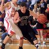 1-16-15<br /> Boys Basketball County Tournament<br /> Western's Austin Weaver dribbles past Taylor's defense.<br /> Kelly Lafferty Gerber | Kokomo Tribune