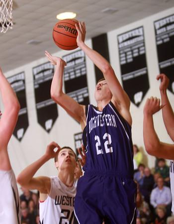 1-17-14<br /> Northwestern vs Western county tournament championship<br /> Northwestern's Quinlan Armstrong shoots.<br /> Kelly Lafferty Gerber | Kokomo Tribune