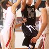 1-16-15<br /> Boys Basketball County Tournament<br /> Western's Gabe Harp goes for a shot as Taylor's defense tries to block him.<br /> Kelly Lafferty Gerber | Kokomo Tribune