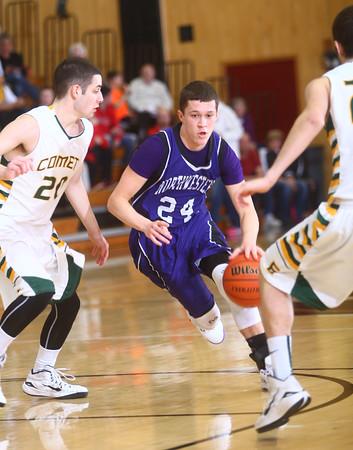 1-16-15<br /> Boys Basketball County Tournament<br /> Northwestern's Blake Oakley dribbles away from Eastern's defense.<br /> Kelly Lafferty Gerber | Kokomo Tribune