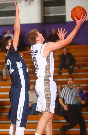 1-6-15<br /> Northwestern basketball<br /> Jacob Wagner goes up for a shot.<br /> Kelly Lafferty Gerber | Kokomo Tribune