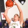 1-16-15<br /> Boys Basketball County Tournament<br /> Eastern's Braden Evans goes up for a shot.<br /> Kelly Lafferty Gerber | Kokomo Tribune