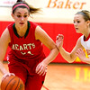 Effingham's Shelby Nunamaker attempts to dribble past Charleston's Dakota Crowder.