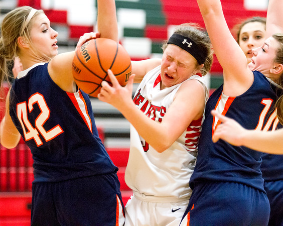 Effingham's Carsyn Fearday gets sandwiched between two Pana defenders.