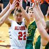 Altamont's Adam Mayhaus looks to kick the ball out after driving into the middle against Patoka.