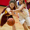 Dieterich's Kaitlyn Bloemer and St. Anthony's Abby Brown battle for a loose ball at the NTC Tournament.