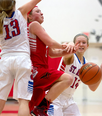 Effigham's Carsyn Fearday drives the lane between St. Anthony's Abby Weis (13) and Emily McDevitt (14).