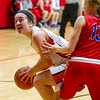 Altamont's Brooke Burns gets around St. Anthony's Abby Weis during the NTC Tournament championship game.