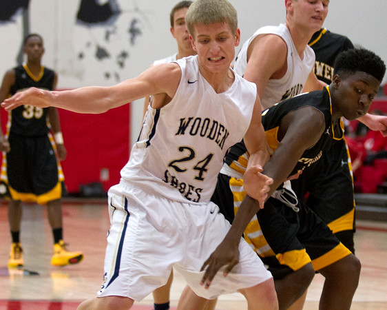 Teutopolis' Kyle Smith fights for a loose ball with Decatur Eisenhower's Yansyn Taylor at the St. Anthony Shootout.