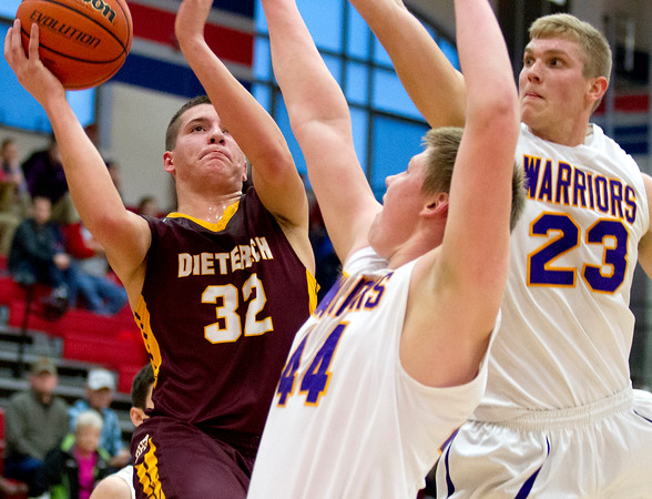 Dieterich's Lance Niemerg goes up for the basket against Casey-Westfield's Luke Richards and Corey Carver at the St. Anthony Shootout.